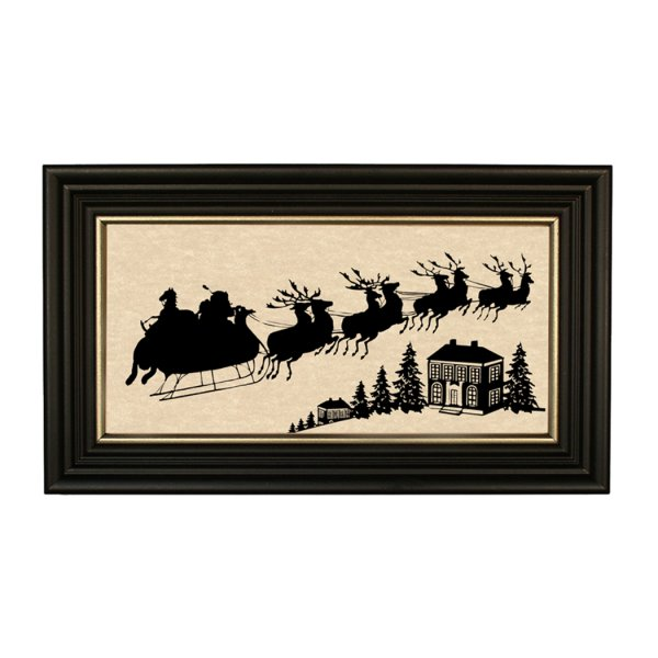 Silhouettes Frames Christmas Santa Clause is Coming Framed Paper Cut Silhouette in Black Wood Frame with Gold Trim. A 5 x 10 framed to 7 x 12.