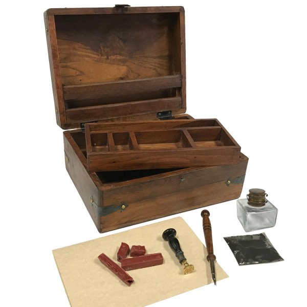 Wood Writing 11″ Distressed Teak Wood Colonial Writing Chest Reproduction with Removable Tray –  Clear Glass Inkwell –  Wood Nib Pen –  Eagle Wax Seal –  Red Wax Pieces –  Black Ink Powder and (3) 5-1/2 x 8-1/2 aged papers.